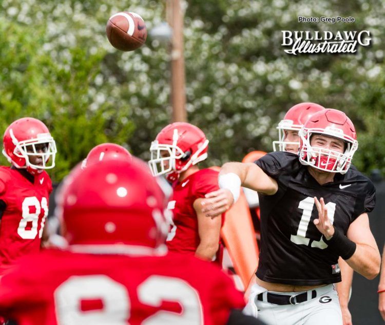 The freshman QB Jake Fromm (11) lets one rip  - UGA football practice, Monday, Aug. 28, 2017 -