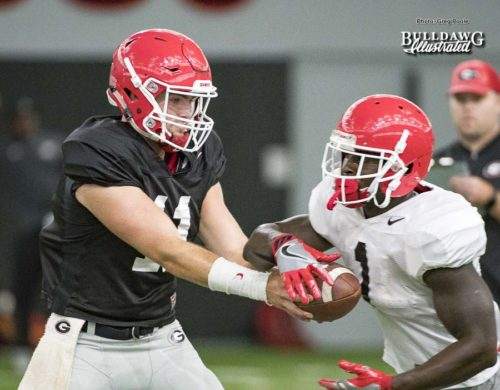 Jake Fromm (11) hands the ball off to Sony Michel (1) - UGA football practice - Wednesday, Sept. 6, 2017