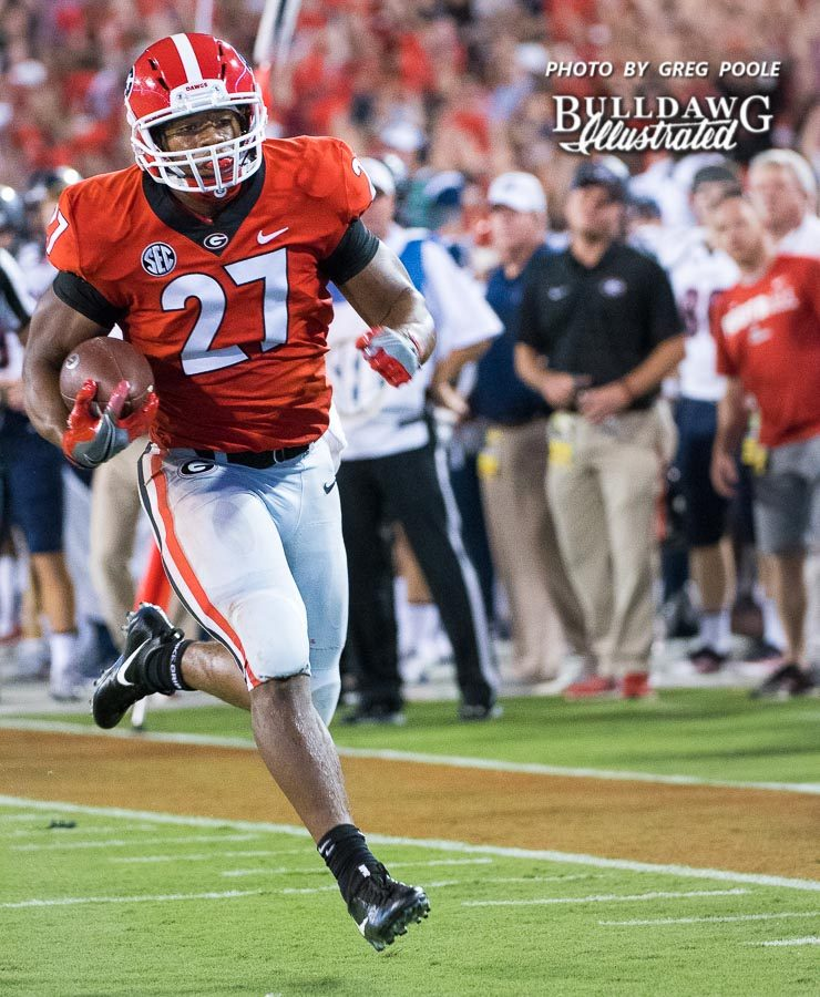 Nick Chubb (27) breaks off a big run during the UGA-Samford game - Athens, GA, Saturday, Sept. 16, 2017 -