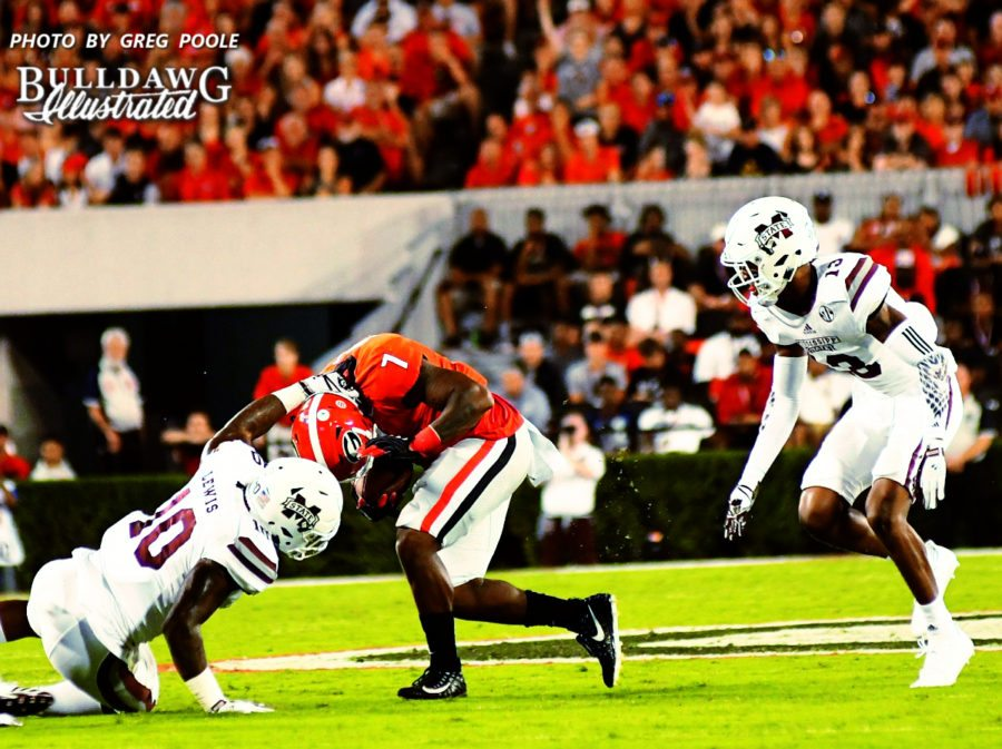 """Georgia runningback D'Andre Swift (7) is """"horse collared"""" by Mississippi State linebacker Leo Lewis (10) - UGA vs. Mississippi State -  Saturday, Sept. 23, 2017"""