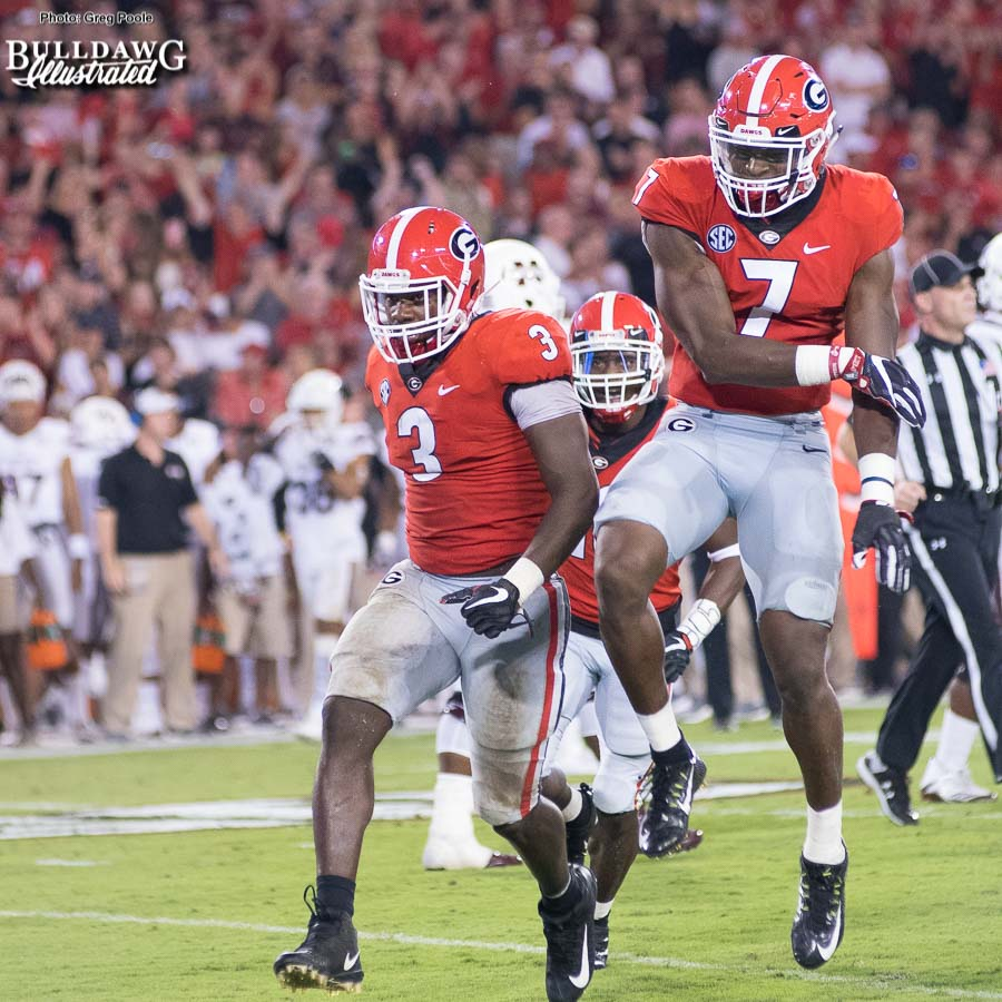Linebackers Roquan Smith (3) and Lorenzo Carter (7) and the Georgia defense come off the field victorious after stopping the Mississippi State offense on another drive - UGA vs. Mississippi State - Saturday, Sept. 23, 2017