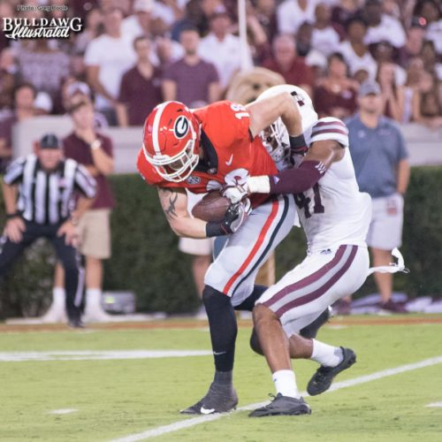 Tight end Isaac Nauta (18) drags Mississippi State safety Mark McLaurin (41) down the field into the end zone to put six on the board for Georgia. - UGA vs. Mississippi State - Saturday, Sept. 23, 2017