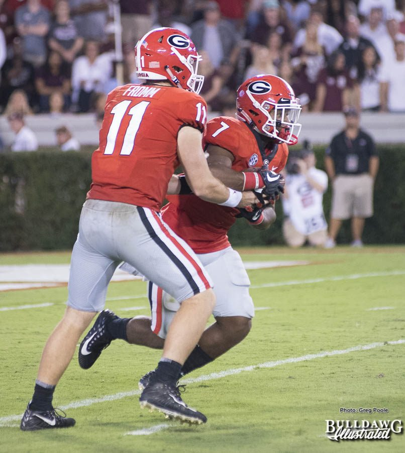 """Jake Fromm (11) hands the """"rock"""" off to fellow freshman and tailback D'Andre Swift (7) - UGA vs. Mississippi State - Saturday, Sept. 23, 2017"""