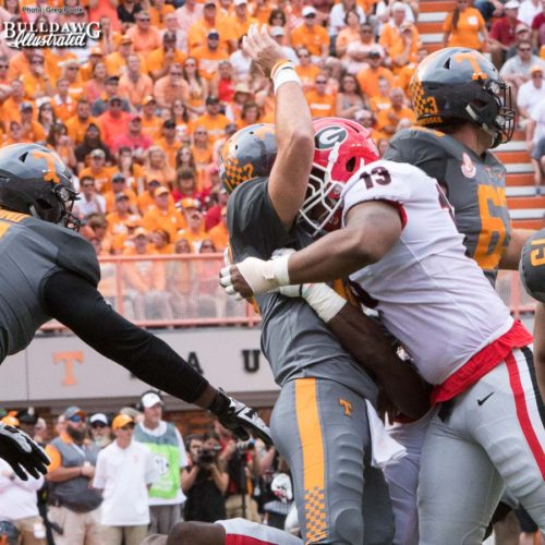 "Jonathan Ledbetter (13) says ""hello with a hug"" to the Vol QB Quinten Dormady - 1st quarter, UGA vs. Tennessee - Saturday, Sept. 30, 2017"