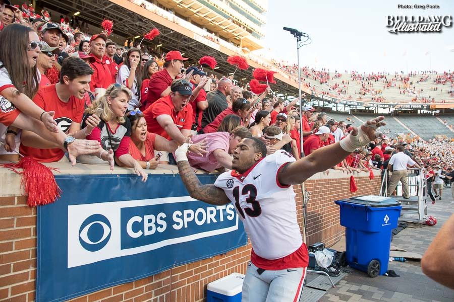 Jonathan Ledbetter (13) celebrates Georgia's 41-0 victory over Tennessee with Bulldog fans. - Saturday, Sept. 30, 2017 -