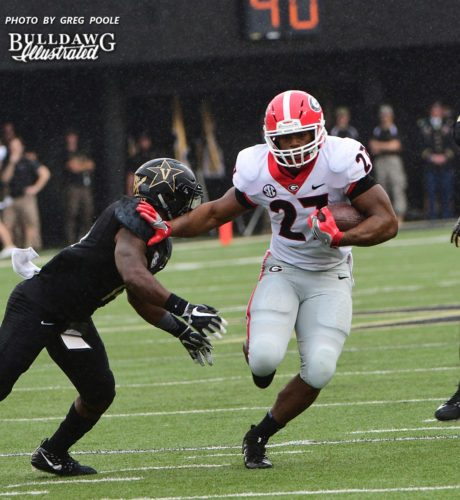 Nick Chubb (27) with a stiff arm on a Commodore - First half of the Georgia vs. Vanderbilt game -  Saturday, October 7, 2017