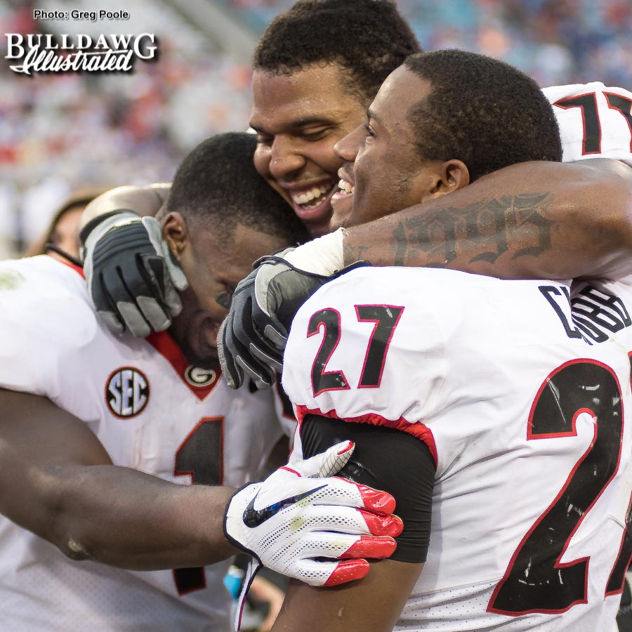 Senior running backs Nick Chubb (27) and Sony Michel (1) celebrate the 42-7 win over the Gators with fellow senior, left tackle Isaiah Wynn. - Georgia-Florida, Saturday, Oct. 28, 2017 -