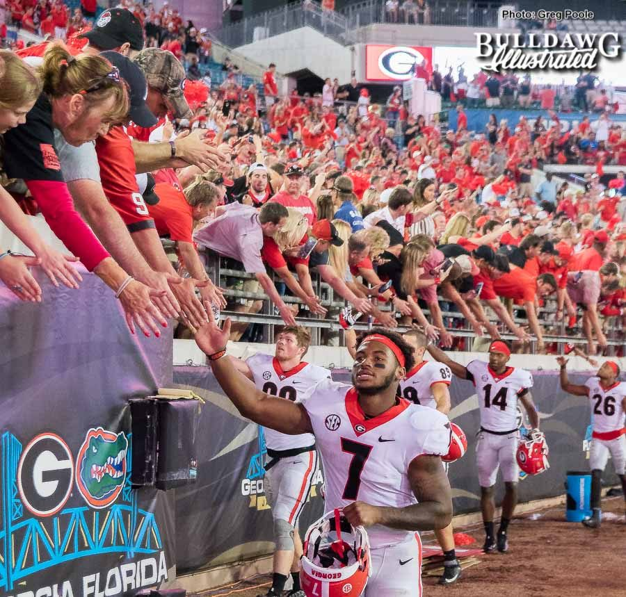 D'Andre Swift (7) and the Georgia football team celebrate a 42-7 win with Bulldog fans over bitter SEC East rival Florida on Saturday, Oct. 28, 2017 in Jacksonville.