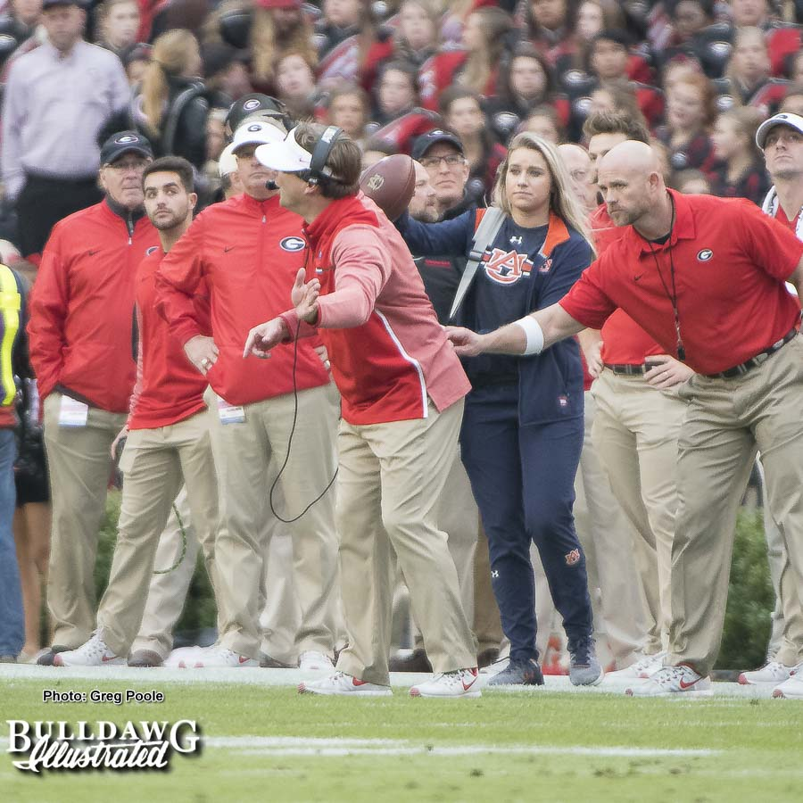 Georgia head coach Kirby Smart being held back to avoid being flagged for a penalty. - UGA vs. Auburn, Sat., Nov. 11, 2017 -
