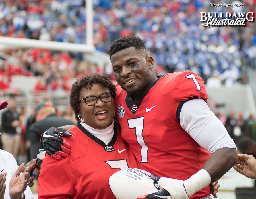Linebacker Lorenzo Carter with his mom being honored on Senior Day at Georgia vs. Kentucky on Saturday, Nov. 18, 2017.