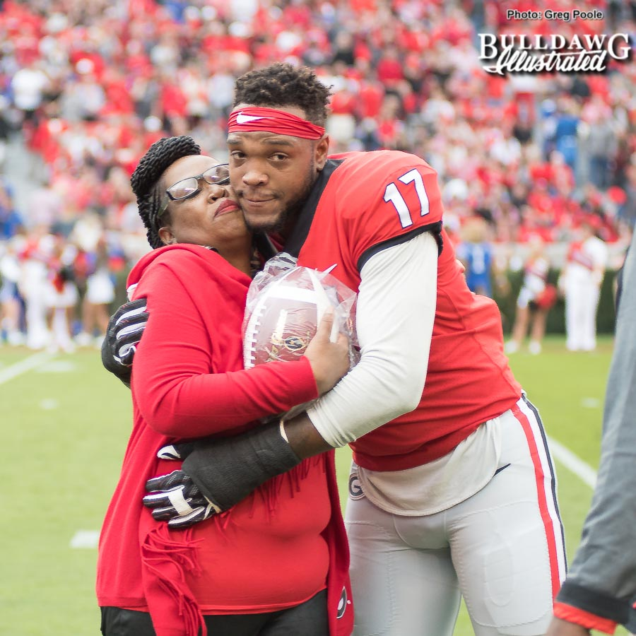 Linebacker Davin Bellamy with his mom being honored on Senior Day at Georgia vs. Kentucky on Saturday, Nov. 18, 2017.