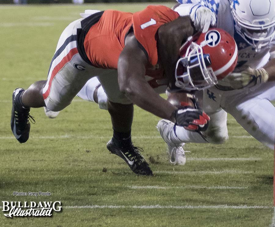 That's one way to bring Georgia's Sony Michel (1) down, but it was not successful. The senior running back made it to the pylon to score six for the Bulldogs. - Georgia vs. Kentucky - Saturday, Nov. 18, 2017