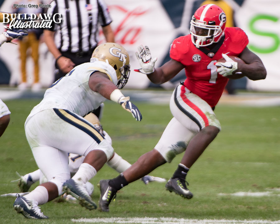Sony Michel (1) leaves a Jacket eating turf and is about to give another one the 'heave-ho' with a stiff arm. - UGA vs. GT - Saturday, Nov. 25, 2017 -