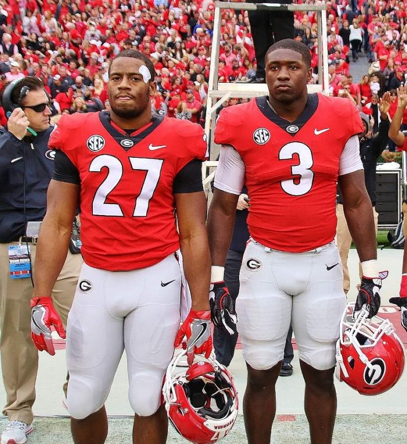 Nick Chubb (27) and Roquan Smith (3) - (Photo by Rob Saye)