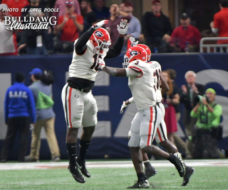 Roquan Smith (3) celebrates with Malik Herring (10) after the Bulldogs defense stops the Auburn offense cold during the SEC Championship game in the Mercedes-Benz Stadium, Saturday, Dec. 2, 2017
