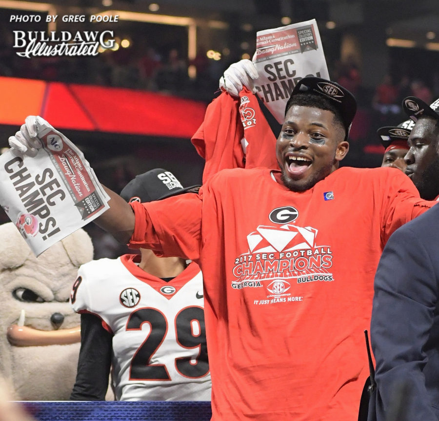 Lorenzo Carter celebrates  with the Georgia football celebrates it's 28-7 victory over rival Auburn in the 2017 SEC Championship to earn the conference crown and title.