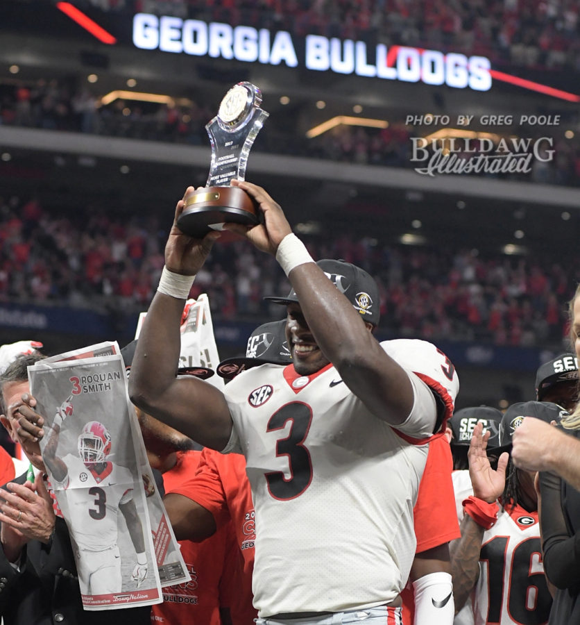 Roquan Smith receives the MVP trophy for his outstanding defensive performance in the 2017 SEC Championship, where Georgia defeated Auburn 28-7.  - Saturday, Dec. 2, 2017 - Mercedes-Benz Stadium, Atlanta, GA -
