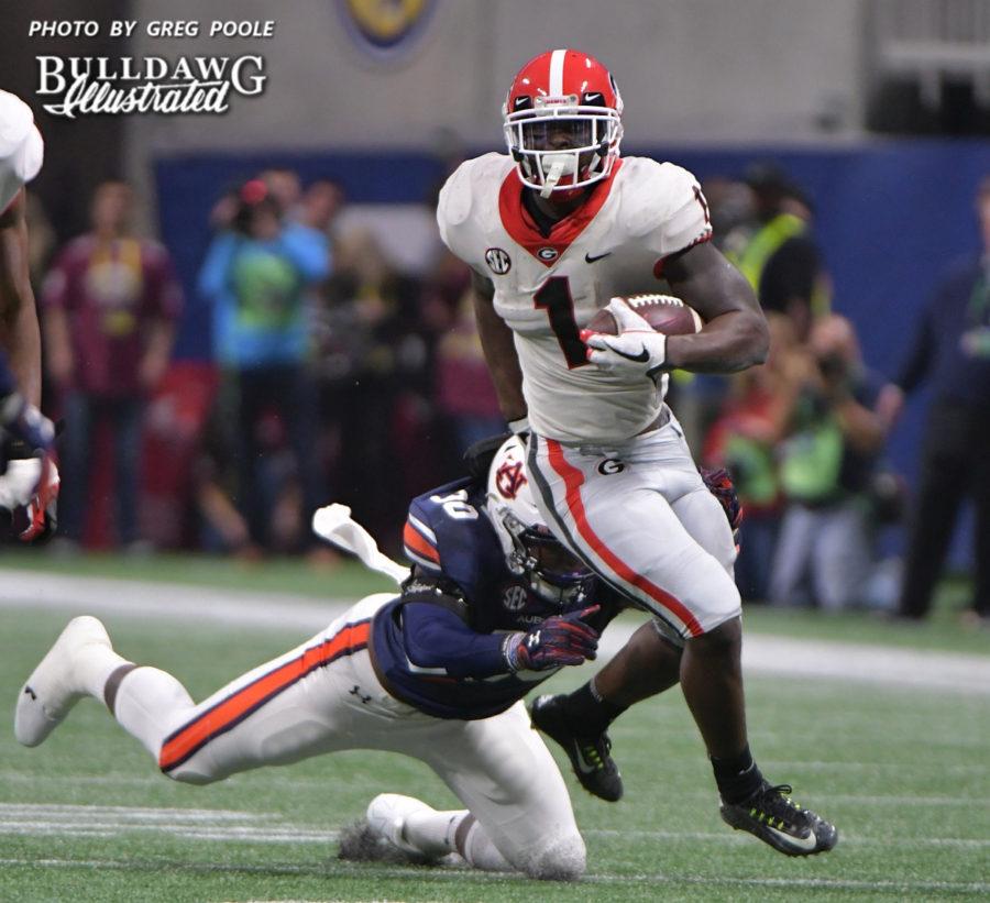 Sony Michel (1) slips an Auburn defender - 2017 SEC Championship, Saturday, Dec. 2, 2017 -