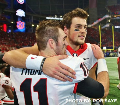 Bulldog quarterbacks Jake Fromm and Jacob Eason celebrate Georgia's 28-7 win over Auburn in the 2017 SEC Championship game.  (Photo by Rob Saye)