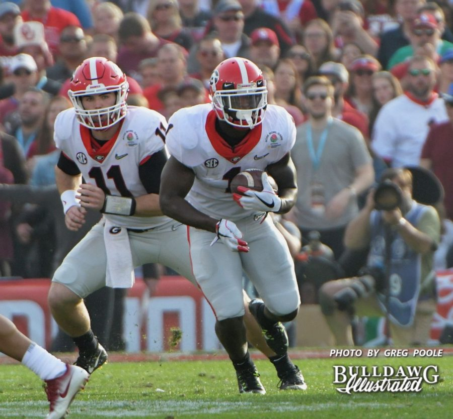 QB Jake Fromm (11) hands the ball off to RB Sony Michel (1) - Rose Bowl, 2nd quarter, Monday, Jan. 1, 2018 -