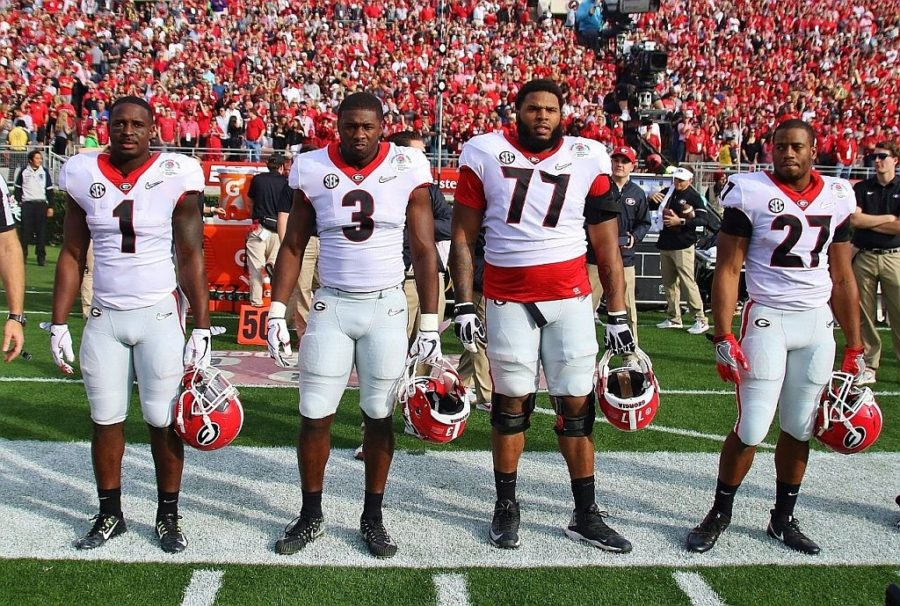 Rose Bowl Game Captains Sony Michel (1), Roquan Smith (3), Isaiah Wynn (77), and Nick Chubb (27) - All four were selected within the first two rounds of the 2018 NFL Draft<br /> (Photo by Rob Saye)