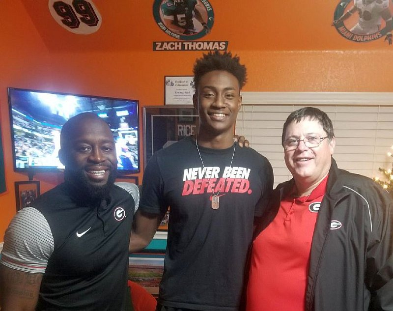 Class of 2018 WR Tommy Bush (middle) with members of the Georgia coaching staff during an in-home visit.  (Photo from Tommy Bush / Twitter)