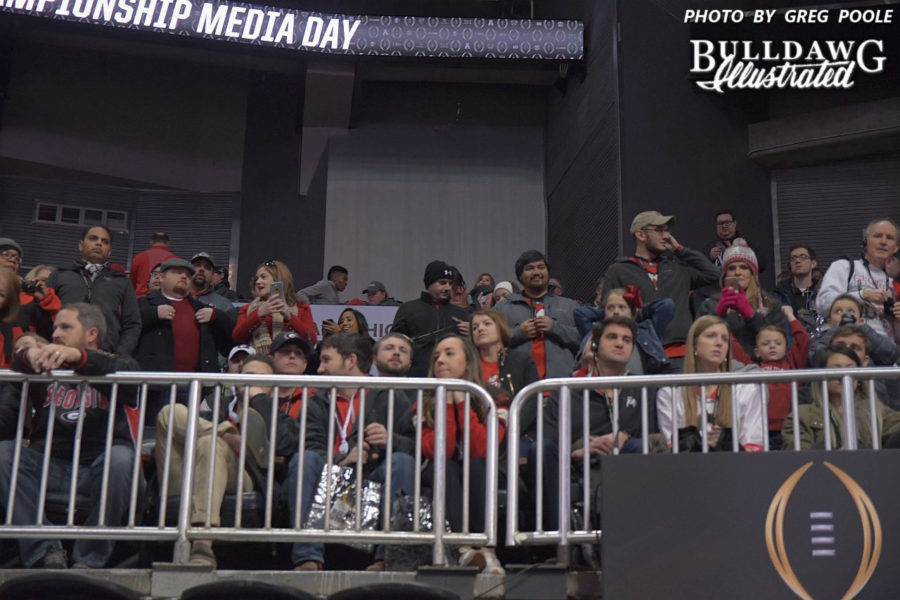 A crowd of fans decked out in red and black await the Georgia players and coaches to make their entrance into Philips Arena for Saturday's College Football Playoff National Championship media day on Jan. 6, 2018.