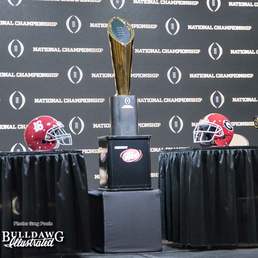 College Football Playoff National Championship trophy on display along with helmets of both the Alabama Crimson Tide and Georgia Bulldogs at the Head Coaches' Presser on Sunday morning.