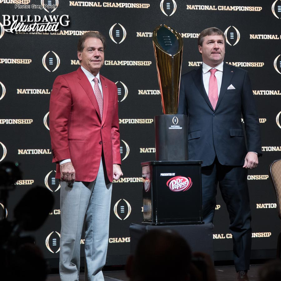 Alabama Head Coach Nick Sabana and Georgia Head Coach Kirby Smart pose with the College Football Playoff National Championship trophy after Sunday morning's press conference, Jan. 7, 2018.