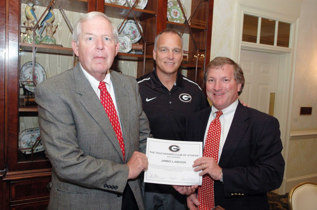 Incoming president, Arthur Steedman recognizes outgoing president Jimbo Laboon, with Mark Richt