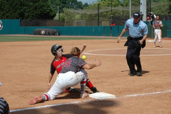 Adele Harrison sliding into third base