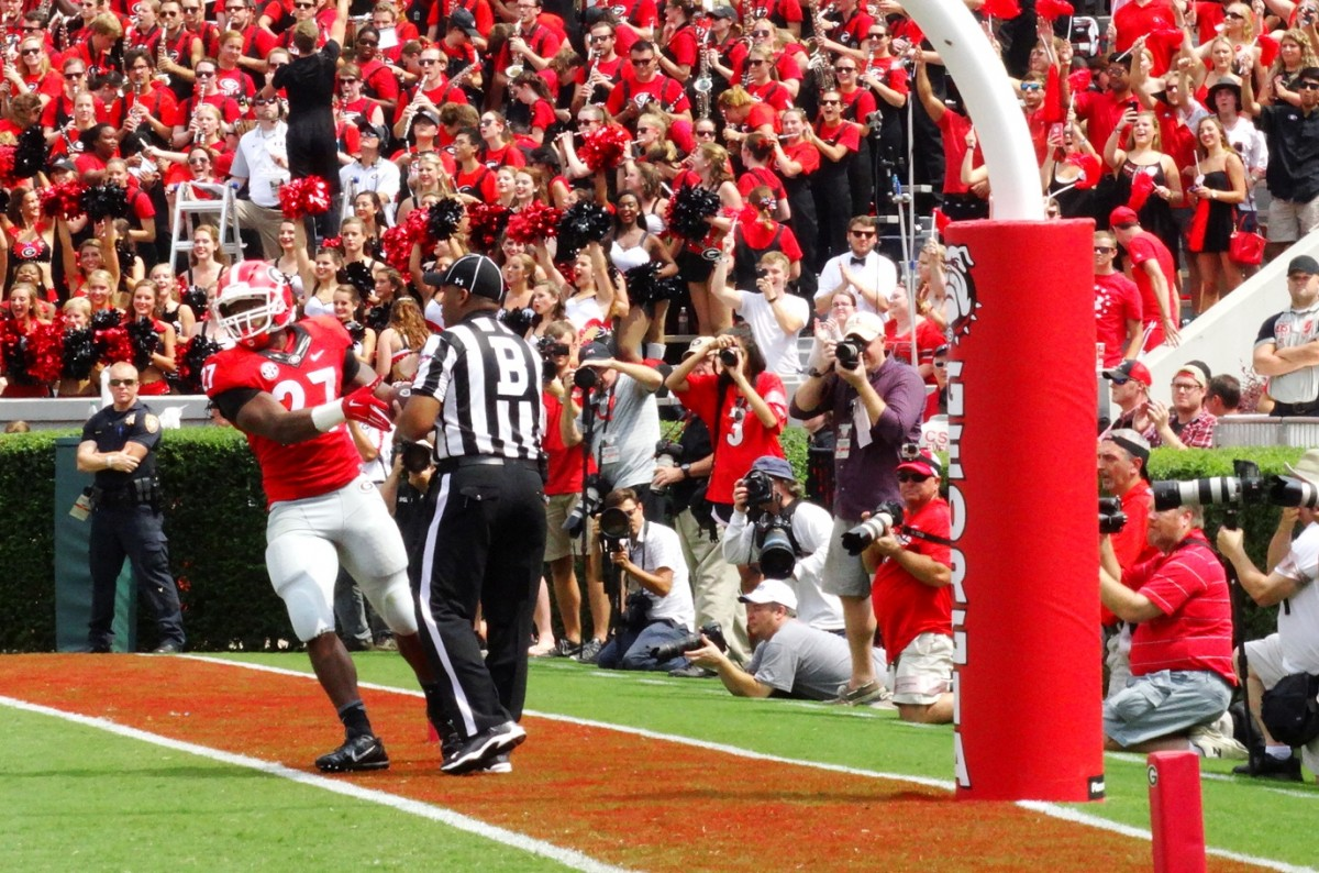 Running back Nick Chubb hands the ball to the ref after a touchdown run. ULM vs. UGA, September 5, 2015. Photo by Greg Poole / Bulldawg Illustrated.