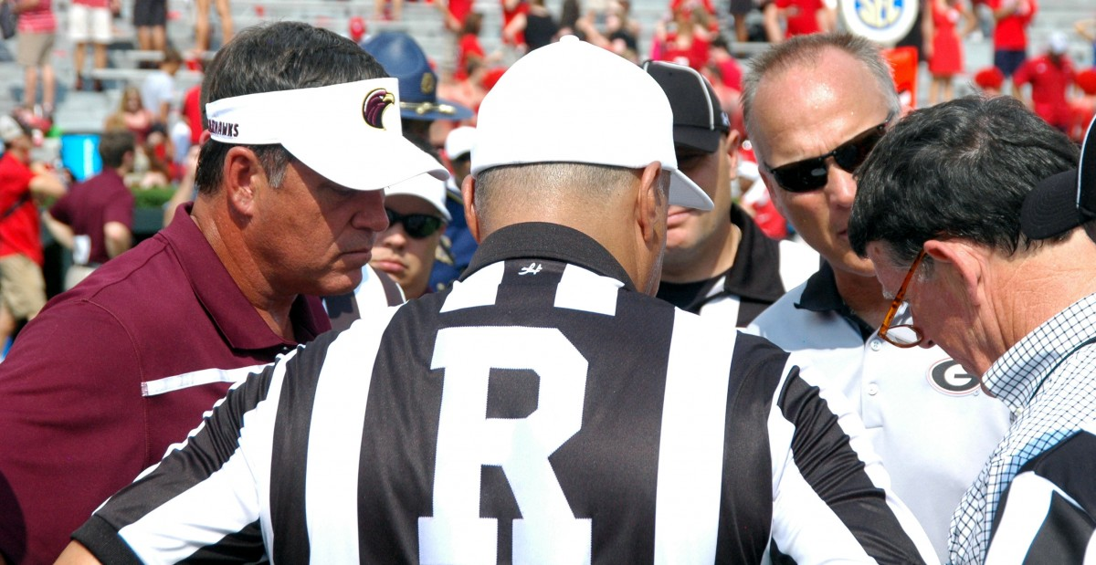 ULM head coach Todd Berry, Coach Richt and AD Greg McGarity huddle to discuss ending the game