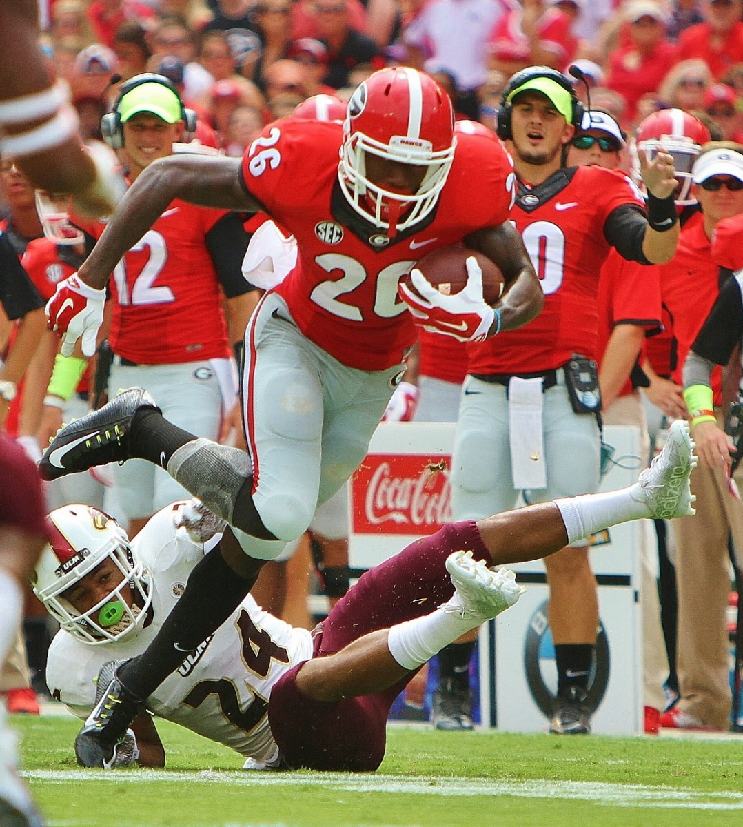Malcolm Mitchell breaks a tackle