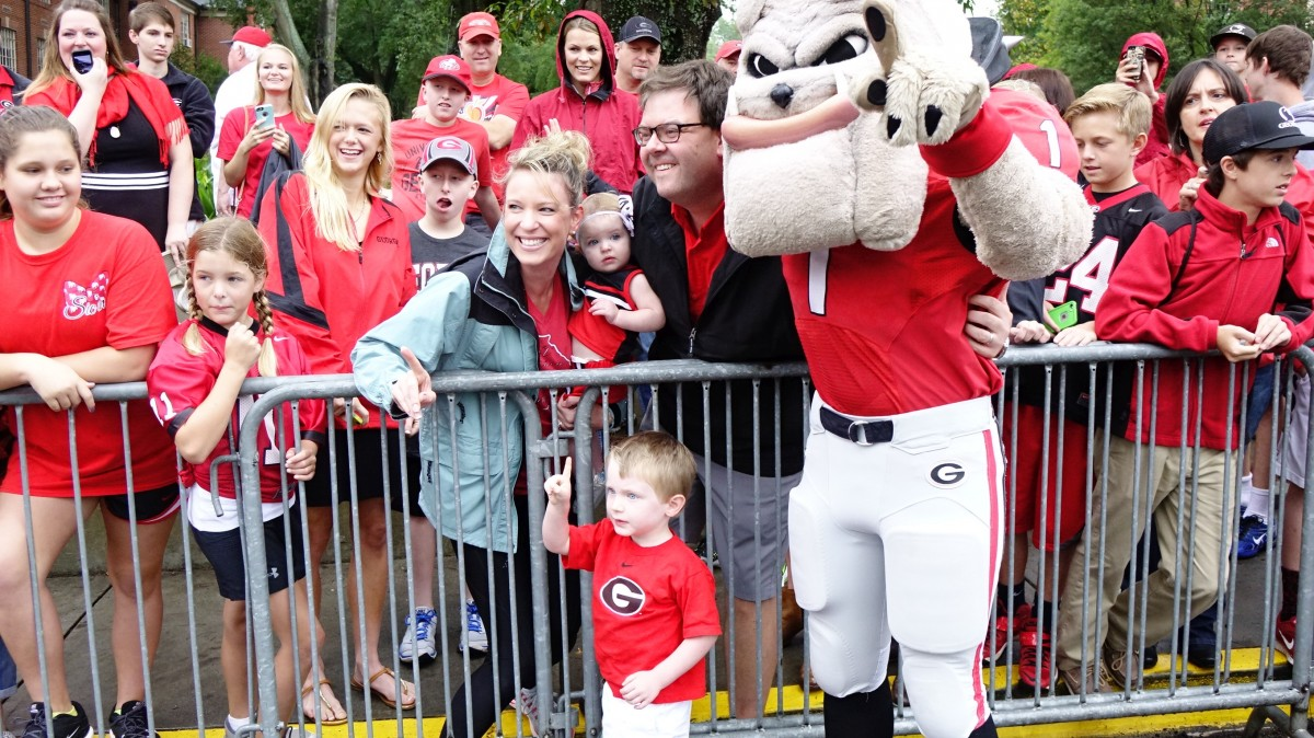 Hairy Dawg with a fan at Dawg Walk for Southern University game 09-26-2015 (Photo by Greg Poole / Bulldawg Illustrated)