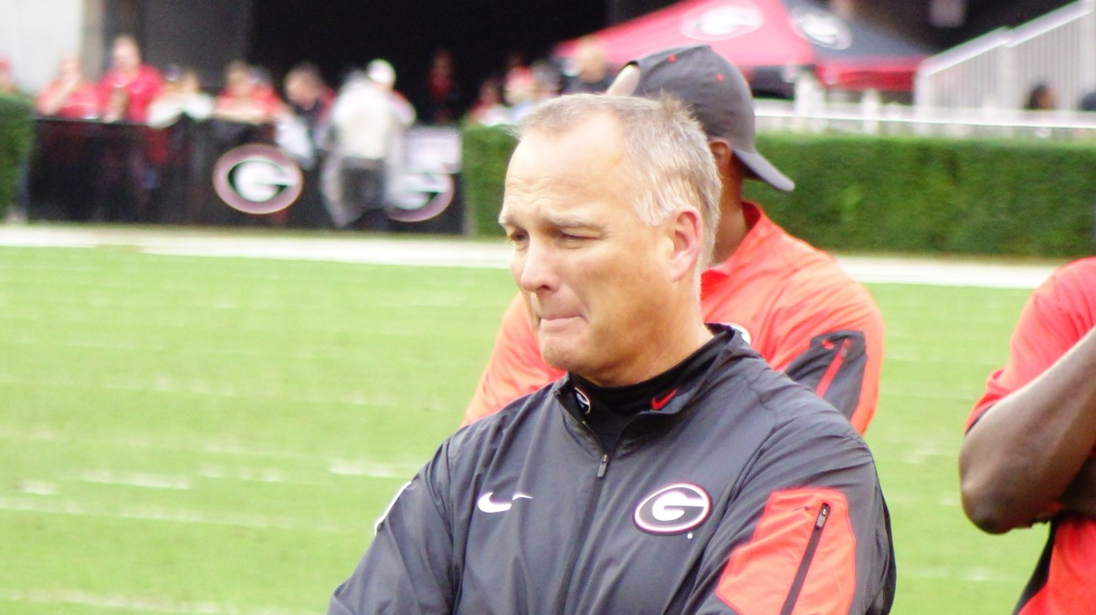 Mark Richt looks on as medical personnel attend to injured Southern University player. Photo: Greg Poole/Bulldawg Illustrated