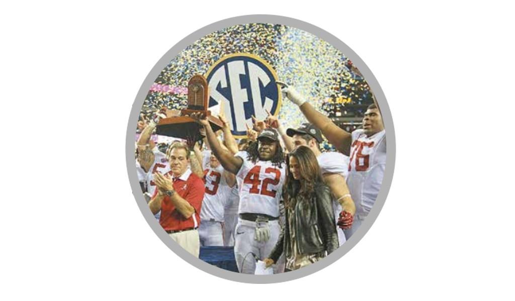 Alabama Crimson Tide and Nick Saban celebrate winning the 2012 SEC Championship (Photo by Rob Saye)