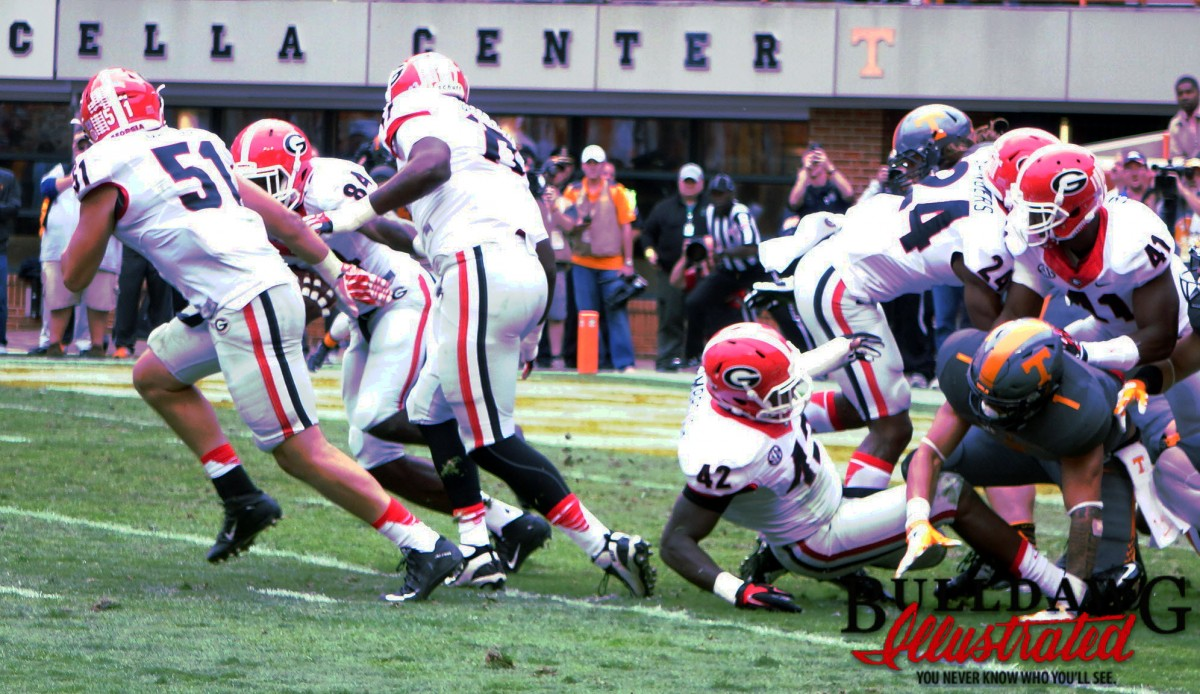 Leonard Floyd collects the ball and takes off