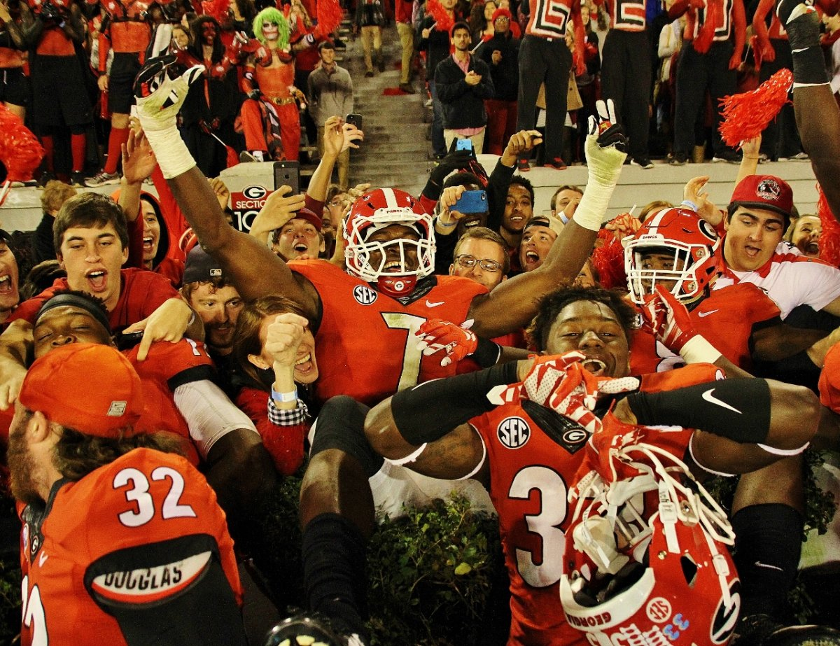 Lorenzo Carter celebrates in the Hedges