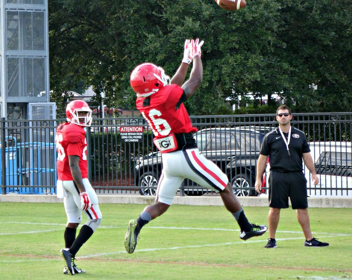 Isaiah McKenzie skies as Mitchell and Hocke watch