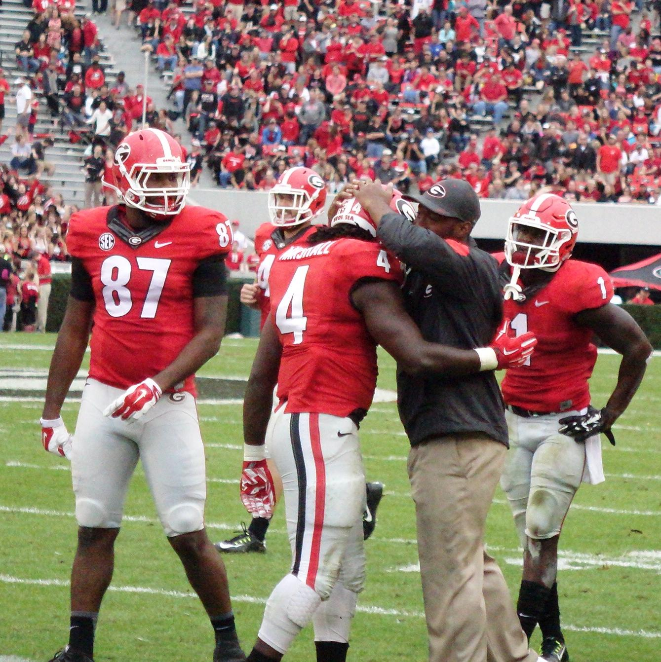 Keith Marshall receives some love from coaches after TD run - 2nd half of Kentucky vs. Georgia 07-Nov-2015 (Photo by Bulldawg Illustrated's Greg Poole)
