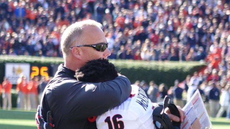 UGA sophomore WR Isaiah McKenzie gets a Coach Mark Richt hug after punt return for TD UGA vs. Auburn 14-Nov-2015 (Photo by Bulldawg Illustrated's Greg Poole)