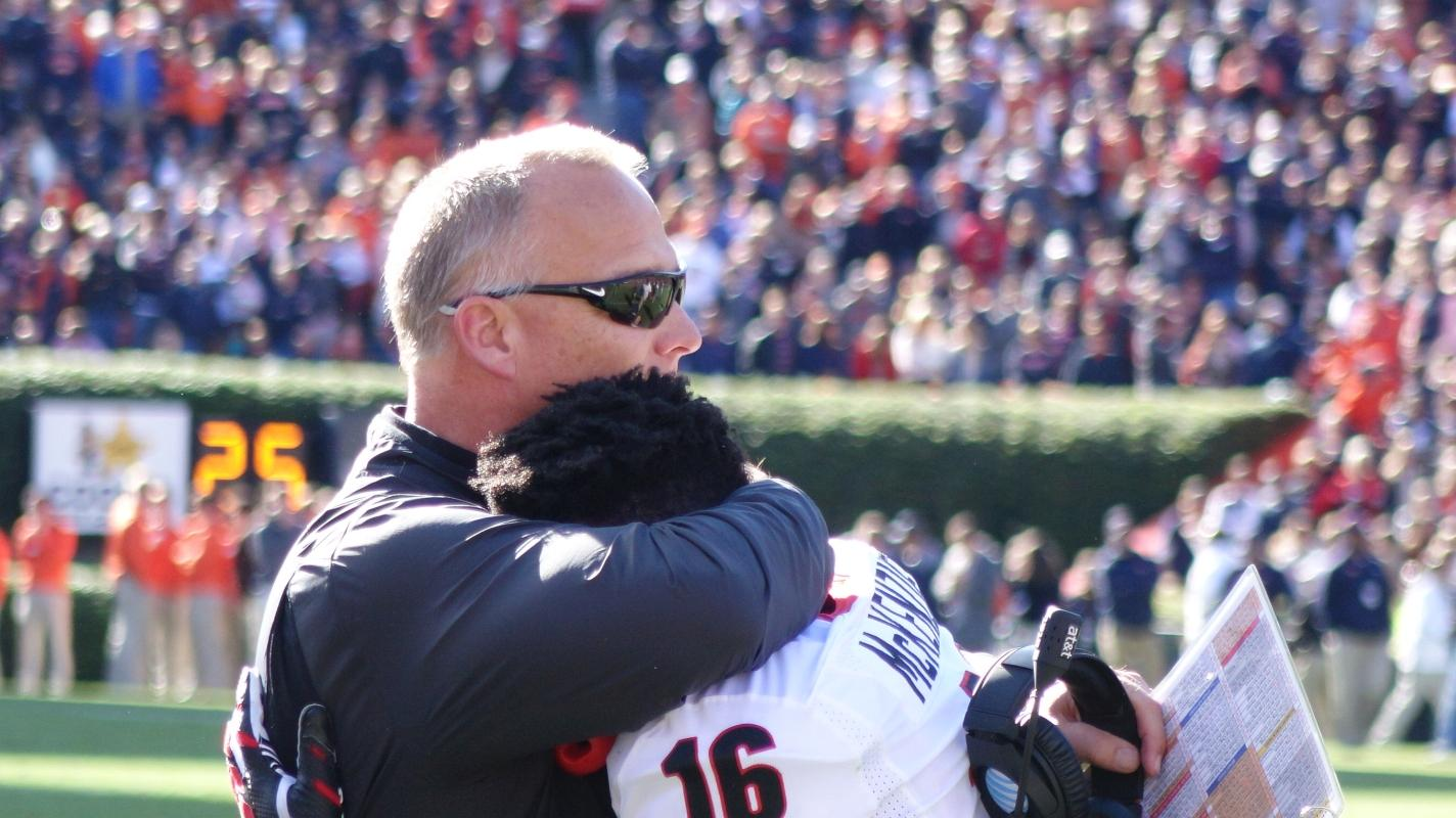 UGA sophomore WR Isaiah McKenzie gets a Coach Mark Richt hug after punt return for TD UGA vs. Auburn 14-Nov-2015 (Photo by Bulldawg Illustrated's Greg Poole)