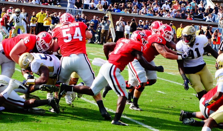Sony Michel drives for yardage