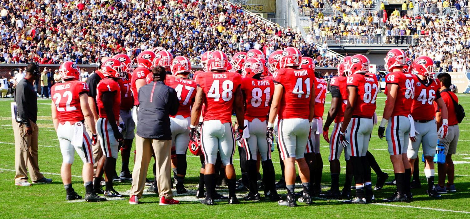 Dawgs offense huddles up - 2nd half UGA vs. GT 28-Nov-2015 (Photo by Bulldawg Illustrated's Greg Poole)