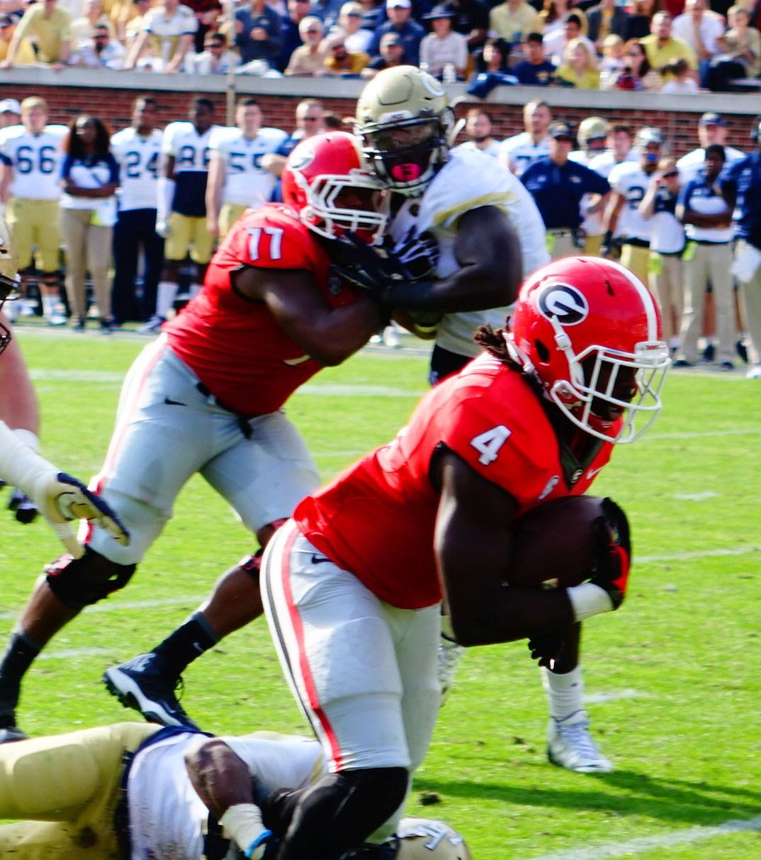 Keith Marshall fights for extra yards - 2nd half UGA vs. GT 28-Nov-2015 (Photo by Greg Poole  - Bulldawg Illustrated)