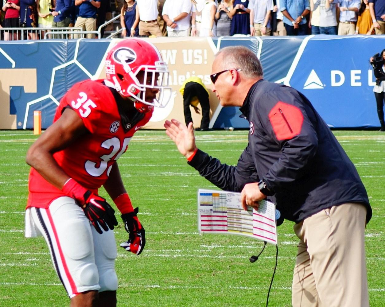 Mark Richt doing some coaching on No.35 Aaron Davis - 4th quarter - UGA vs. GT 28-Nov-2015 (Photo by Greg Poole - Bulldawg Illustrated)