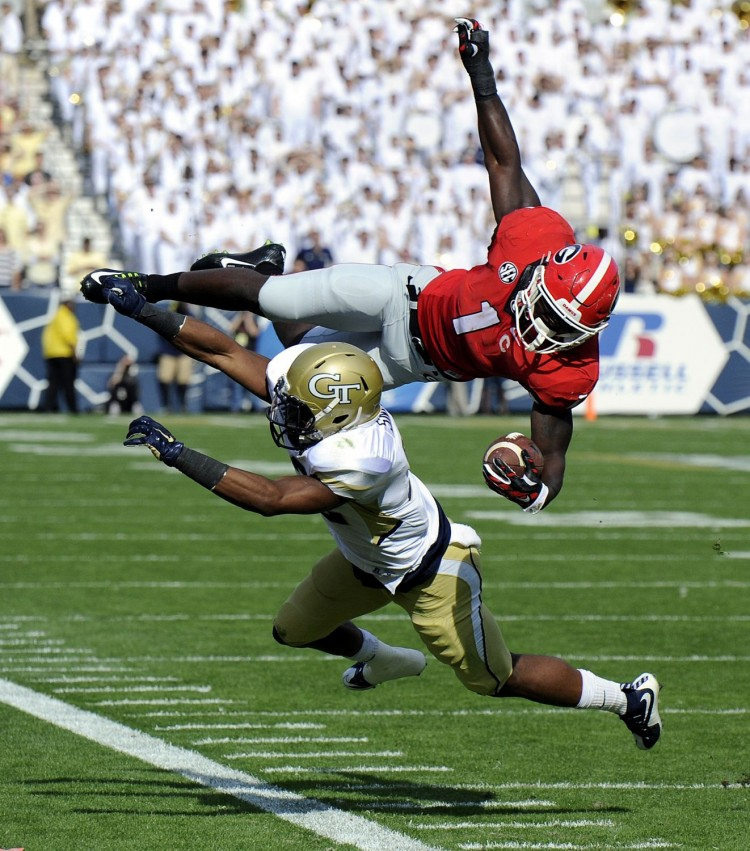 Sony Michel goes airborne (Photo by John Kelley)
