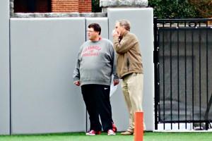 Jim Chaney and Mike Cavan watch OL drills