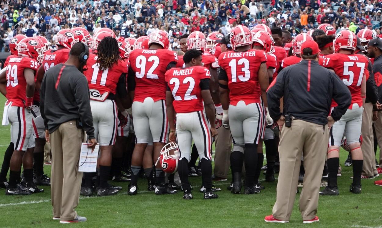 Georgia huddles up - 1st half TaxSlayer Bowl 02-JAN-2016 (Photo by Greg Poole)